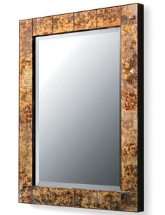 Downtown's églomisé mirror reproduces the timeless look of tortoiseshell on its glistening back-painted glass frame.