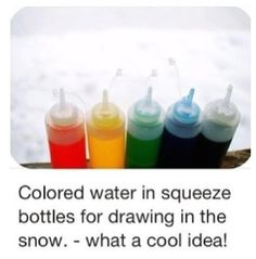 colored water in squeeze bottles for drawing in the snow