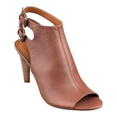"""Blurring the line between booties and peep-toe sandals, our Miraculous booties feature an open back and dual-buckle closure. These booties also have that wear-anywhere versatility. Padded footbed for all-day comfort. Leather upper. Man-made lining and sole. Imported. Stacked 3"""" heels. Peep toe booties."""
