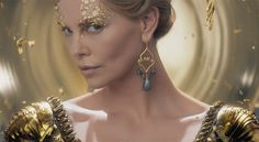 Charlize Theron is stunning as the Evil Queen Ravenna in The Huntsman Winter's War. Beautiful make up effect with the gold leaf around her eyes. The gown looks to be very detailed. Colleen Atwood is back as costume designer for this follow up to Snow White and the Huntsman.