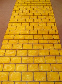Follow the Yellow Brick Road - An Isle Runner from The Original Runner Company.  This was used in one of David Tutera's weddings