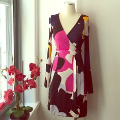 DVF Abstract Print Wrap Dress Gorgeous colors to use for the summer, bell sleeves, fabric: jersey silk. Mint condition. All reasonable offers are welcome! Please make all offers through the offer button Diane von Furstenberg Dresses