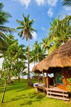 Tropical Beach Cottage. I bet Jimmy Buffet lives here & he's got his blender fired up! LOL