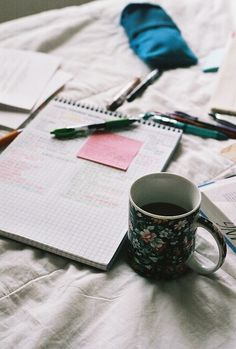 Coffee and notes in bed. inspiration