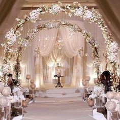 Arches and drapes, chandeliers and up lights...very pretty!