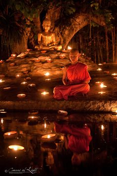A young meditating monk during the Visakha bucha holiday in Chiang Mai, Thailand.