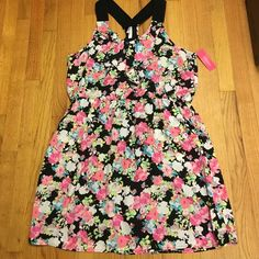 NWT flowery racer back dress Brand new with tags flowery racer-back dress with a little ruffle on the front. So cute and easy to wear.  Has lining.  Xhilaration Dresses