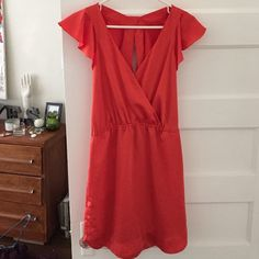 Persimmon silk BCBG dress Ruffled sleeves, v neck in front, open back with Ruffles, pockets. BCBGeneration Dresses