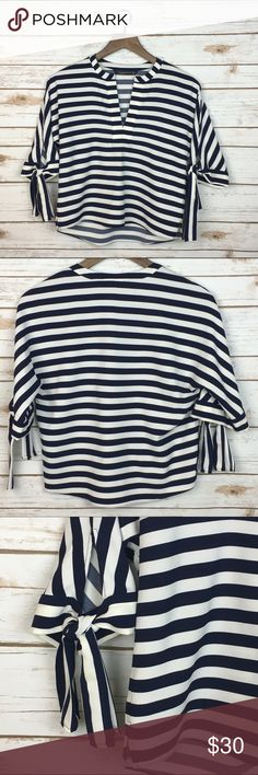 """[Zara] Navy Stripe Tie Sleeve Top Blouse Crop Chic Beautiful slightly cropped striped blouse. Loose fit with dolman short sleeves. adjustable ties at edges. Split v-neck. Perfect with high waisted bottoms.  Fabric: Polyester  Bust: 19"""" Length: 21"""" Condition: EUC. No flaws.  Measurements taken while lying flat. Zara Tops Blouses"""
