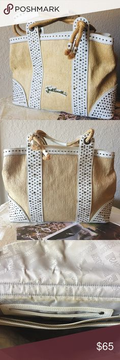 """Just Cavalli Bag Woven raffia Just Cavalli tote with bronze tone studs hardware. Magnetic closure at front flap. Overall good condition. My bags are usually clean as I use a pouch for my stuff (I don't put them directly inside the bag) unfortunately something must have spilled as reflected on pricing.  Approx  H 10.5""""x W 15"""" x 4.5inches depth Strap Drop 7"""" Just Cavalli Bags Shoulder Bags"""