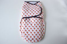 Baby swaddler, swaddle blanket/wrap, white / orange nautical sailboat pattern. $40.00, via Etsy.