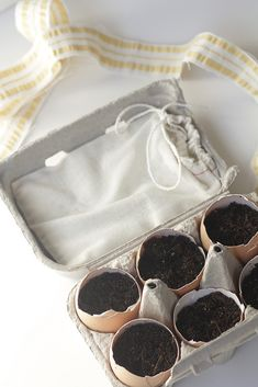 Egg Carton Herb Garden: All you need is a half carton of eggs, a few seed packets, some soil, and a label. If you sprout your seeds in an eggshell with a little bit of soil, you can plant the whole thing when it's ready, eggshell and all!  LOVE this idea for a hostess gift!