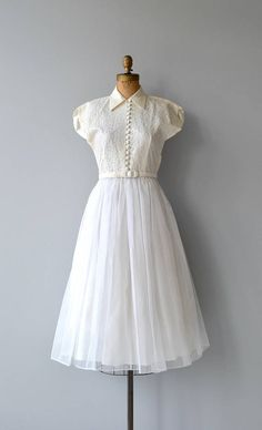 Vintage 1950s white wedding dress with white lace bodice, high buttoning collar, button bodice, short dolman sleeves, fitted waist, matching belt and full skirt. Metal zipper. --- M E A S U R E M E N T S --- fits like: small bust: 34-36 waist: 27 hip: 40 length: 46 brand/maker: n/a condition: excellent ✩ layaway is available for this item To ensure a good fit, please read the sizing guide: http://www.etsy.com/shop/DearGolden/policy ✩ more vintage dresses...