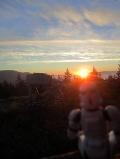 Stormtrooper action figure photograph with AT AT watching the sunset.  Action figure photograph available on www.ThatsHeavyDoc.com for purchase.  Comes as 8x10 or 11x14.