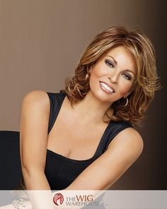 The versatile medium-length layers of the Embrace wig by Raquel Welch can create just the look you want, from straight and sleek to wavy or curly. Side swept bangs blend into shoulder-grazing layers o