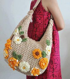 This bag is made with polyester yarn, all hand crochet with flower applique, the weight of the bag is about It has lining, zipper and 3 inner pockets. AB: CD: EF: Handle: wide and 16 long Bottom: 5 wide Crotchet Bags, Bag Crochet, Crochet Handbags, Crochet Purses, Crochet Beanie, Knitted Bags, Crochet Stitches, Free Crochet, Crochet Flower Patterns