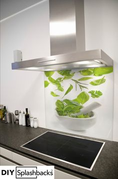 Falling herbs printed glass splashback. Shop from over 400 designs, or provide your own. All of our splashbacks are: Heat Resistant to 200 degrees, toughened safety glass, available in any size, and all come with a seven year warranty. Visit diysplashbacks.co.uk to discover more.