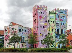 The Happy Rizzi House is a famous tourist attraction in the German city of Braunschweig. It was created in 1999 by an American artist James Rizzi. The Happy Rizzi House is a famous tourist Interesting Buildings, Amazing Buildings, Unusual Buildings, Attractions In Germany, Roadside Attractions, James Rizzi, Houses In Germany, Art Nouveau, Colourful Buildings