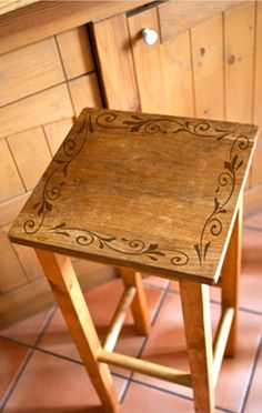 Paint a simple stencil on a plain stool to spruce it up for any home decor upcycle project.