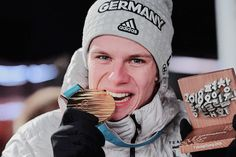 German ski jumper Andreas Wellinger and biathlete Laura Dahlmeier pose with their country first gold medals at 2018 Winter Olympics at the Medal Plaza in PyeongChang, South Korea, on Feb. 2018 Winter Olympics, Ski Jumping, Jumpers, Athletes, Skiing, Germany, Sky, Athlete, Ski