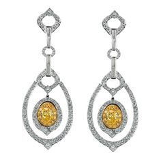 Yellow and white diamond earrings by GUMUCHIAN