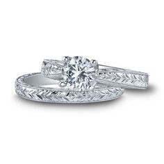 Picture of Kirk Kara Hand Engraved Stella Engagement Ring in 18kt White Gold Featuring 0.05 Carats Round Diamonds.