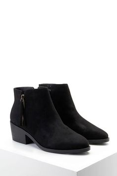 A pair of faux suede booties featuring zippered sides, a textured block heel, and an almond toe.