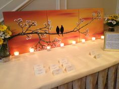 Love this home made painting on the place card table