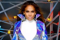 """Former American Idol judge and pop singer Jennifer Lopez premiered the very colorful music video for her single, """"Goin' In,"""" on Wednesday. The song, featuring rapper Flo Rida, was released to promote upcoming dance flick Step Up Revolution and J. Lo's greatest hits album, Dance Again... The Hits. See the music vidoe and read the full story here: www.examiner.com/article/jennifer-lopez-premieres-colorful-clip-for-goin-featuring-flo-rida"""