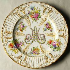 Marie Antoinette's China pattern with gold trim and floral accents created by Andre-Marie LeBoeuf.  Discontinued in 1780.