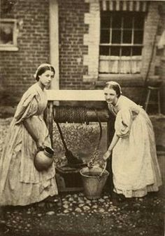 An beautiful photo of two young British maids in 1864.