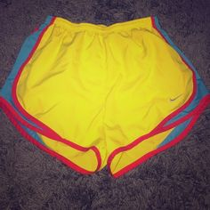 Nike Tempo Short yellow, red and blue Nike Tempo running short. size S. small hole in the front, as seen in pic 4, but nothing noticeable and nothing to worry about. super cute, bright colors ! Nike Shorts