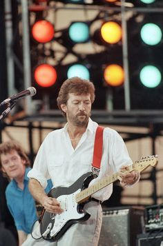 FILE - In this July 13, 1985 file photo, Eric Clapton performs at the Live Aid concert in ...