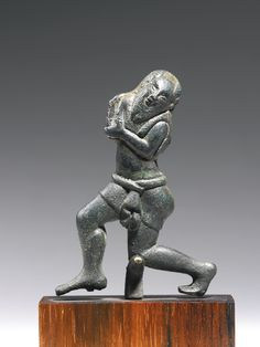 An Etruscan Bronze Figure of a Silen, circa Late 6th Century B.C.
