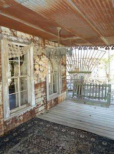 Porch Detail.    Robin Brown and John Gray of Magnolia Pearl Clothing are selling their incredible ranch in Bandera, Texas.