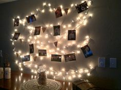 A new decor idea for those twinkle lights! All I did was clothespin some of my wedding pics to it.
