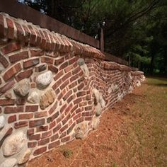 """Historical Bricks: Old Pasadena Clinkers - This collection offers clinkers in the red color family, some with black marks from overheating. Their distorted and twisted shapes invite show-stopping, freeform installations that will set your property apart from all others. Clinker """"clumps"""" are also available to coordinate with the individual bricks."""