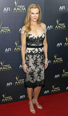Also spotted in a Collette Dinnigan was Aussie beauty Nicole Kidman, who perfectly paired her sophisticated dress with a diamond hairpiece, matching cuff, and silver sandals. Simply gorgeous! (1/27/2012)