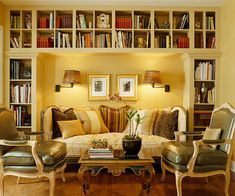 Library idea that centers around seating. Note lighting, placement of furniture, simple use of accessories. Bookcases painted to match color of wall.