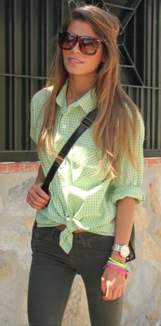 green shirt, grey ant sunglasses and mid high waisted jeans. Love it