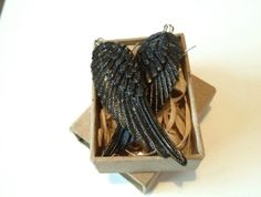 Black wing earrings check out http://felt.co.nz/listing/165304/Black-Bird-Wing-Earrings  to purchase!