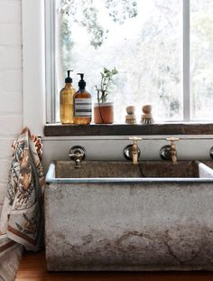 Soapstone sink with brass fittings