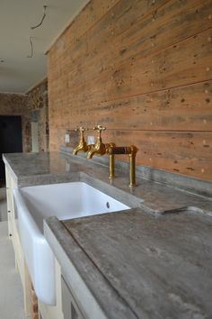 I like the way this sink is integrated into the benchtop and the rustic taps... the concrete bench could work in as the island as well