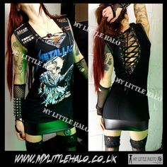 Sexy Metallica studded mini dress in with v neck bustline featuring lace up, studded faux leather shoulders and a sexy open, adjustable lace up back