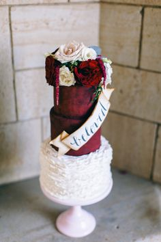 Rose topped red wedding cake with calligraphy and ruffle details | Nikki Santerre Photography | see more on: http://burnettsboards.com/2014/05/loving-type-wedding-inspired-love-letters/