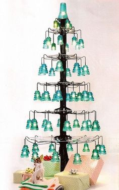 Vintage glass electric insulators are so cool! What were they used for? They were used to separate theelectricalwires from the wooden t... Noel Christmas, Vintage Christmas, Christmas Crafts, Christmas Decorations, Holiday Decor, Elegant Christmas, Christmas Ideas, Insulator Lights, Glass Insulators