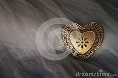 Photo about Heart of golden metal on a silk background. Image of affection, metal, silk - 137527100 Brooch, Stock Photos, Silk, Heart, Metal, Image, Jewelry, Jewlery, Jewerly