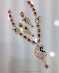 Gold plated peacock necklace studded with sparkling CZ stones and pink ruby stones. For inquiries please contact the seller below. Seller Name : Swarnakshi Ruby Jewelry, India Jewelry, Bridal Jewelry, Peacock Jewelry, Peacock Necklace, Gold Earrings For Women, Gold Jewelry Simple, Bollywood Jewelry, Gold Jewellery Design