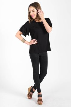 This black frill sleeve goes great with skirts or your favorite pair of jeans.
