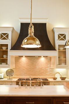 Traditional Kitchen with High ceiling, Hammermarc Custom Copper - RH004 Range Hood - Dark Patina, Subway Tile, Kitchen island.  COPPER PENDANT!!!